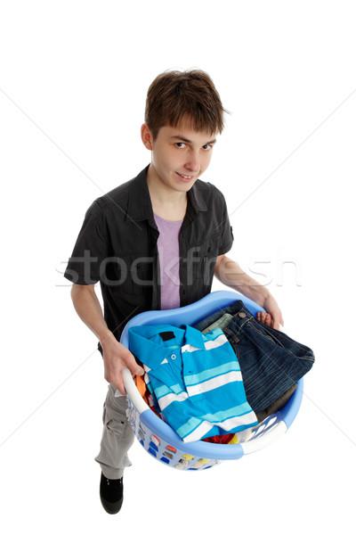 Tiener mand wasserij glimlachend strijken Stockfoto © lovleah
