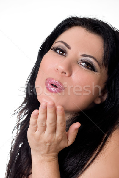 Girl blowing a soft kiss Stock photo © lovleah