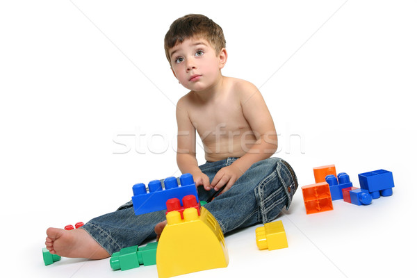 Young boy amongst building blocks Stock photo © lovleah