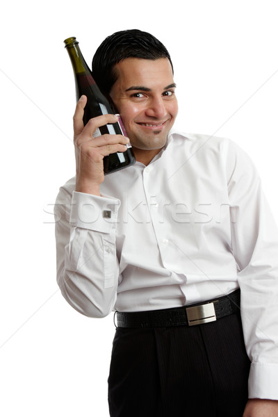 Boldog férfi borosüveg tart fehér dolgozik Stock fotó © lovleah