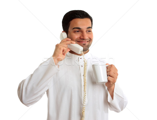 Traditional ethnic business man talking on telephone Stock photo © lovleah