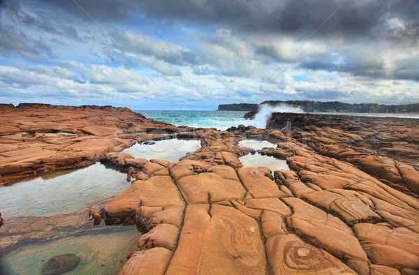 Waves splash on magnificent rock formations Stock photo © lovleah