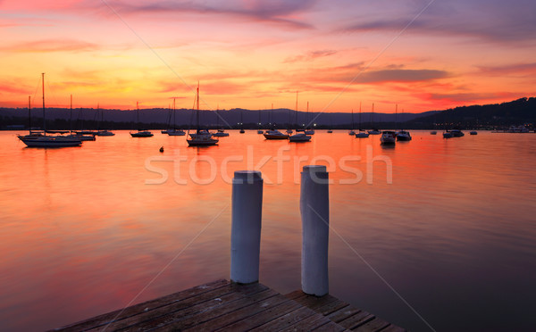 Boats on the harbour at sunset Stock photo © lovleah