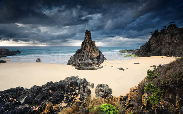 Moody storm clouds loom over Pyramid sea stack Stock photo © lovleah