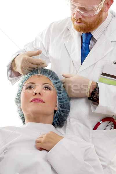 Doctor giving a Botox injection Stock photo © lovleah
