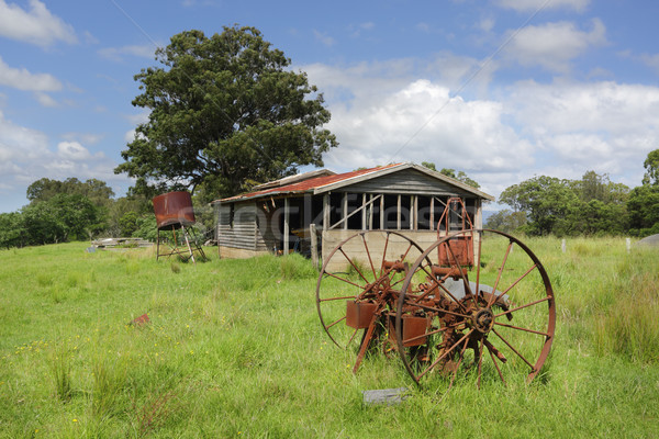 Old derelict farm shed and rusty cart wheels at Benandarah Stock photo © lovleah