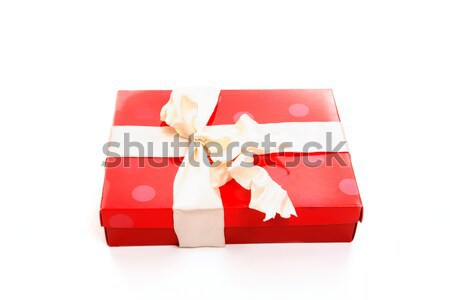 Stock photo: Red box tied with cream ribbon bow