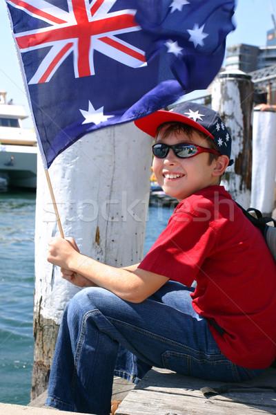 Boy on harbourside pier waving flag Stock photo © lovleah