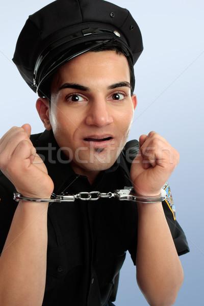 Polis kelepçe çılgın eller tutuklama adam Stok fotoğraf © lovleah