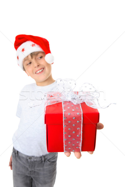 Boy with present looking sideways Stock photo © lovleah