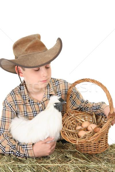 Farm boy with basket of eggs Stock photo © lovleah
