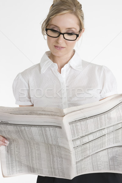 Businesswoman reading financial newspaper Stock photo © lovleah