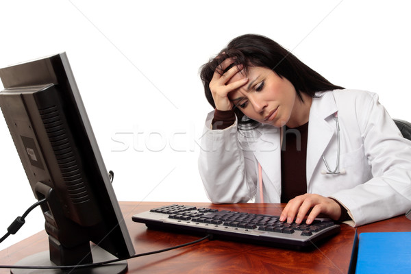 Overworked tired doctor at computer Stock photo © lovleah