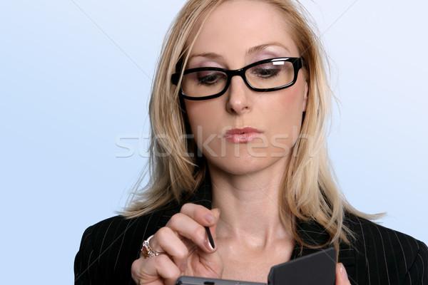 Woman using her organiser Stock photo © lovleah