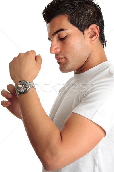 Man putting on chronograph watch Stock photo © lovleah
