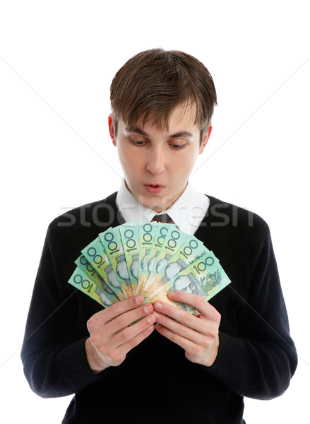Student or young worker looking down at handful of cash Stock photo © lovleah