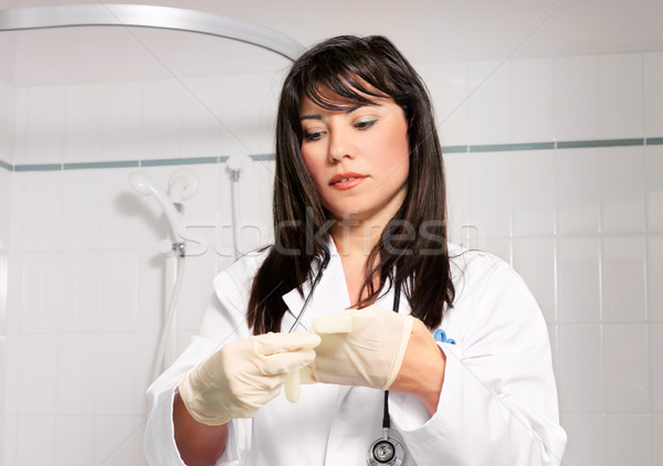 Doctor or surgeon scrubbing up  Stock photo © lovleah