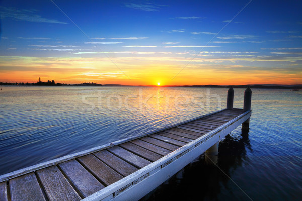 Setting sun behind the boat jetty, Lake Maquarie Stock photo © lovleah