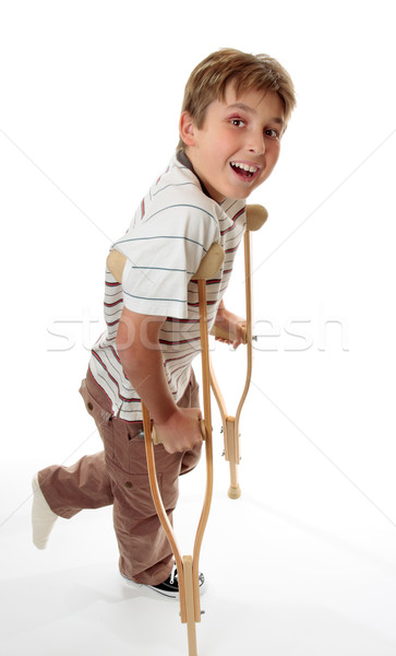 Smiling boy on crutches Stock photo © lovleah