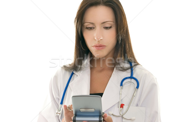 Doctor referencing information on a portable device Stock photo © lovleah