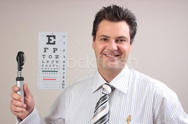 Orvos optometrikus derűs szemorvos tart szemek Stock fotó © lovleah