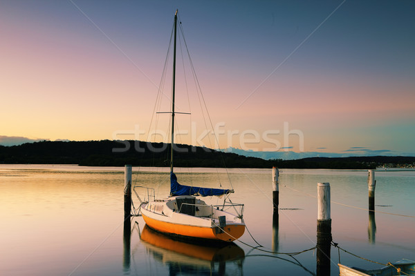 Little Sailing Boat at Woy Woy at sunrise Stock photo © lovleah