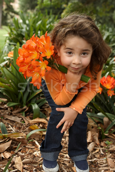 Young girl with a bunch of lilies Stock photo © lovleah