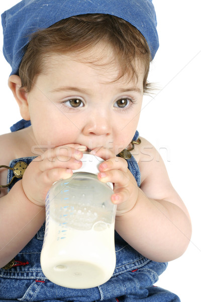 Baby with milk bottle Stock photo © lovleah