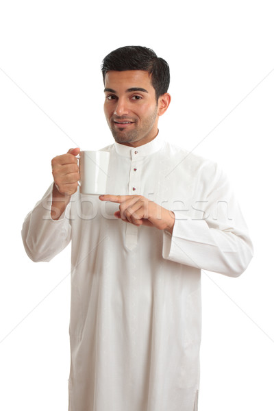 Arab ethnic man showing coffee Stock photo © lovleah