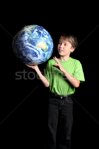 Boy holding Earth in his hand and looking with wonder fascinatio Stock photo © lovleah