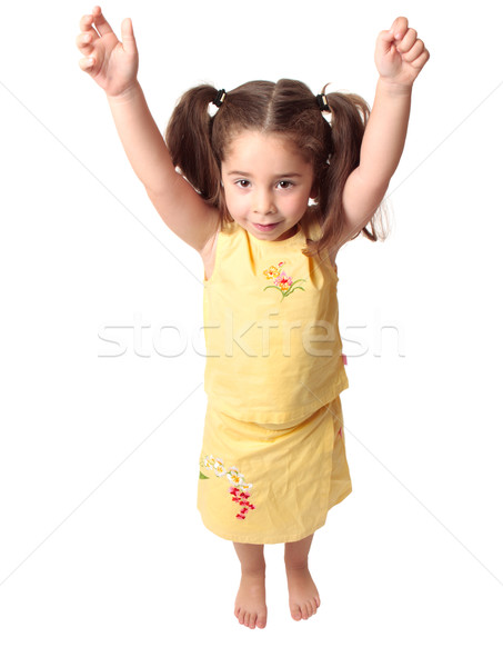 Preschool girl with arms raised above head Stock photo © lovleah
