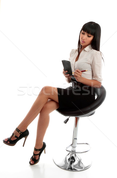 Businesswoman taking dictation or notes Stock photo © lovleah