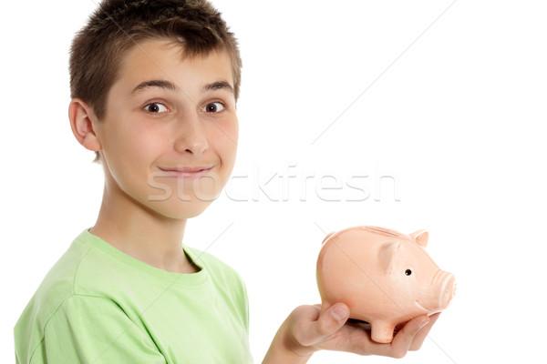 Boy holding a money box Stock photo © lovleah