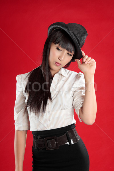 Woman wearing a hat and  tilting head Stock photo © lovleah