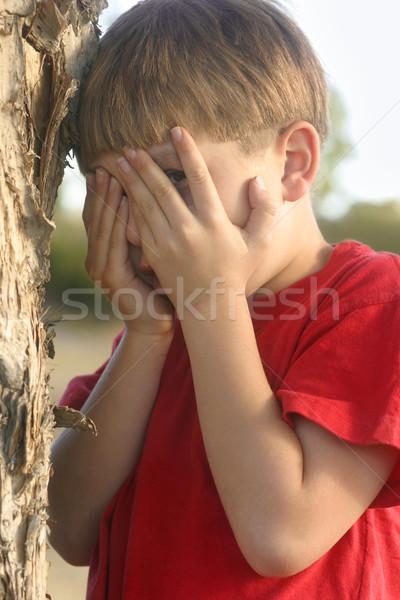 Boy playing hide and seek Stock photo © lovleah