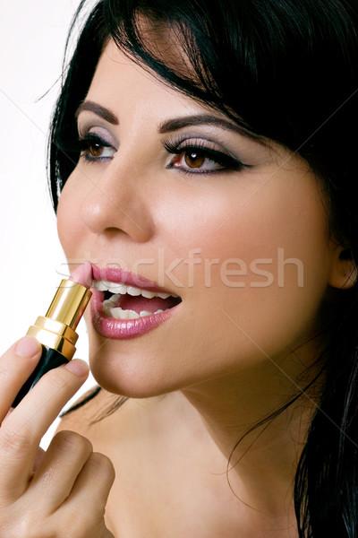 Gyönyörű nő jelentkezik rúzs nő smink rózsaszín Stock fotó © lovleah