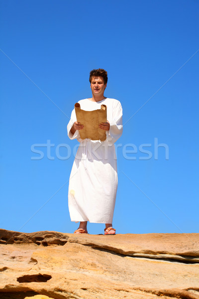 man reading scroll in rocky desert land scape Stock photo © lovleah