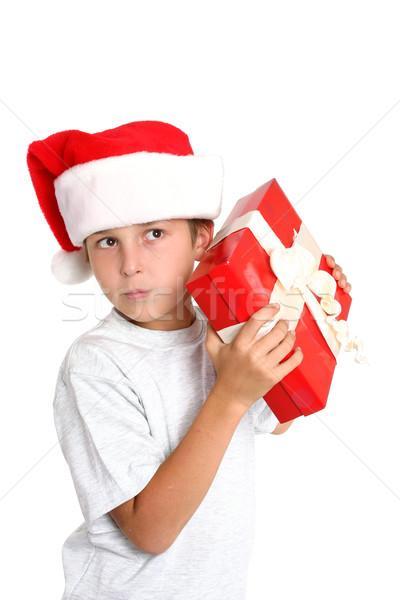 Boy curious Christmas present Stock photo © lovleah