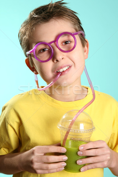 Boy with a healthy superjuice Stock photo © lovleah