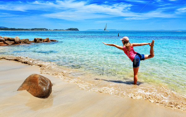 Holiday yoga on a secluded beach Stock photo © lovleah