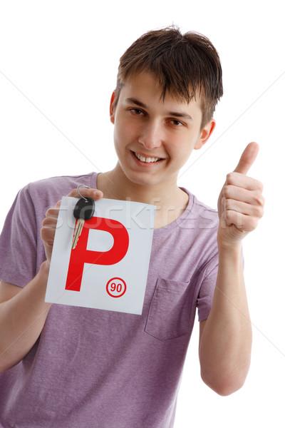Teen boy holding P plates and car key Stock photo © lovleah