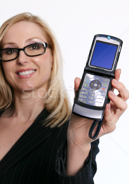 Famale holding an open flip cell phone Stock photo © lovleah