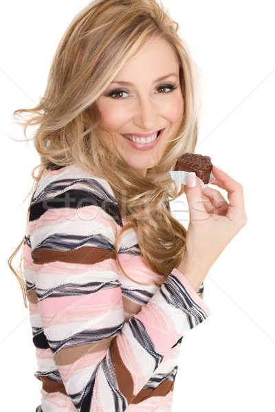 Stock photo: Indulgence.  Female holding a decadent chocolate truffle