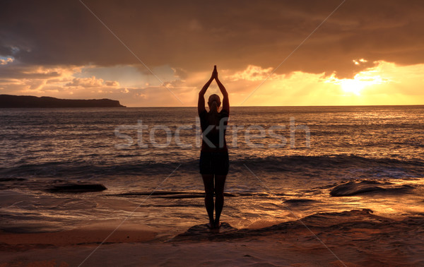 Woman Tadasana  -  Mountain Pose  yoga by the sea at sunrise Stock photo © lovleah