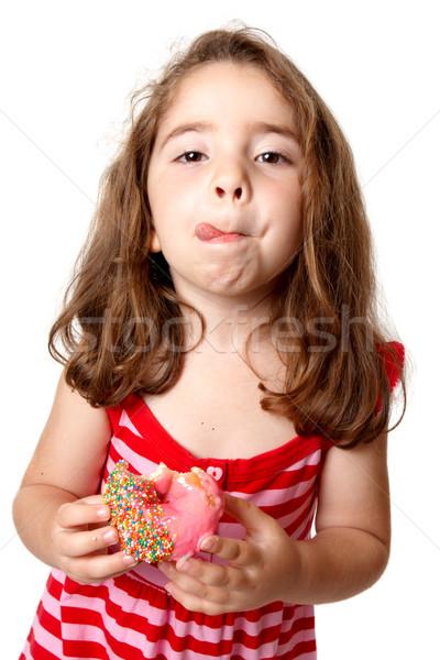 Girl eating doughnut licking lips Stock photo © lovleah