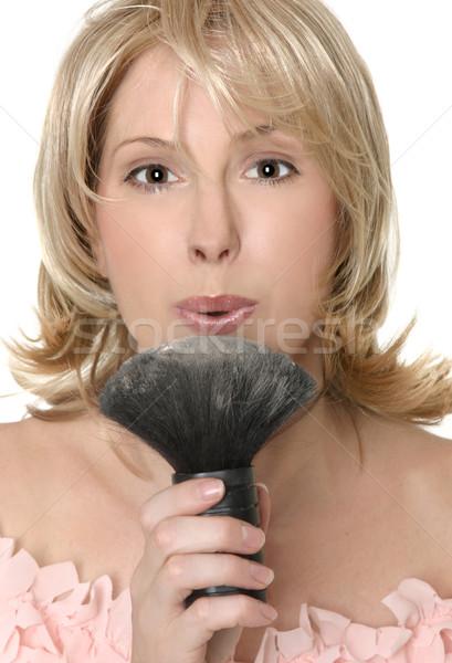 Női folyik túlzás por sminkecset fúj Stock fotó © lovleah