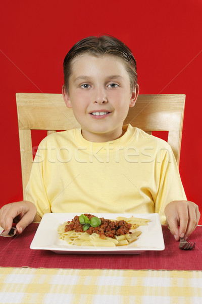 Child at dinner table with plate of food Stock photo © lovleah