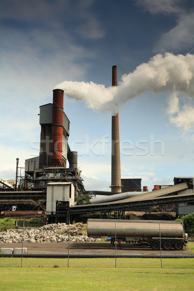Stock photo: Active steel mill smelter emiting billowing toxic fumes