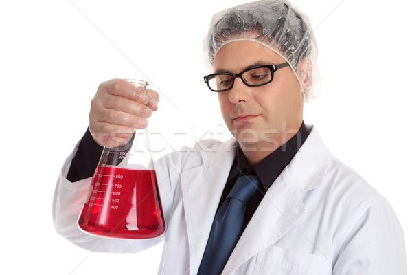 Chemist carrying large flask Stock photo © lovleah