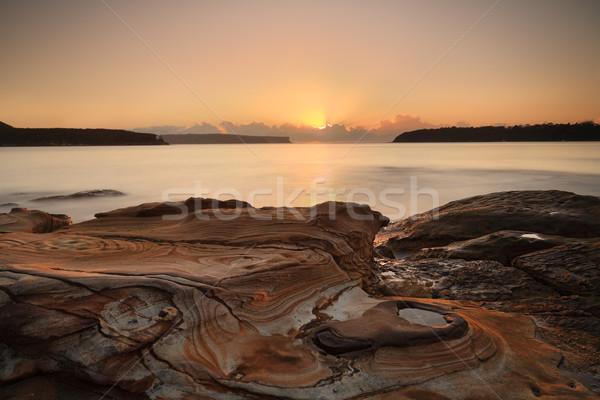 ストックフォト: 日の出 · ビーチ · かなり · 砂岩 · 岩 · 入り口